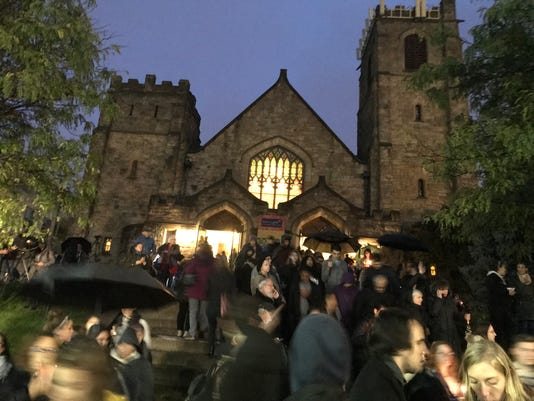 Pittsburgh -- Residents gather outside of the Sixth Presbyterian Church located at the corner of Murray and Forbes Ave. in Pittsburgh PA during a candlelight vigil mourning the victims of Tree of Life synagogue shooting on Saturday, October 27, 2018.