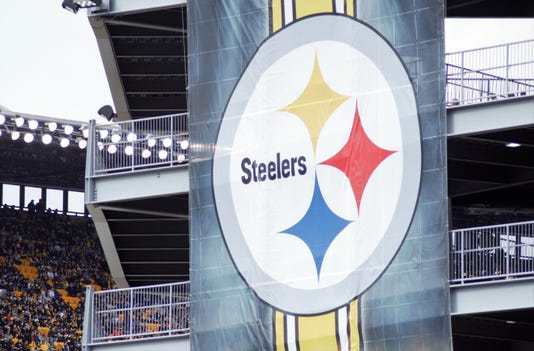 Outside of Heinz Field minutes after a moment of silence was held for the synagogue shooting victims on Sunday, October 28.