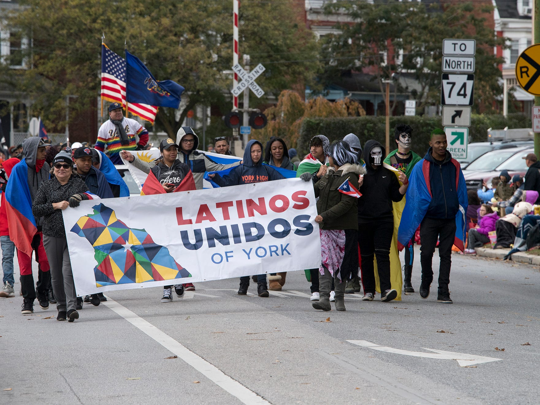 Latinos Unidos of York opens the 69th Annual York Halloween Parade presented by York Traditions Bank Sunday in York works its way east on Market Street.