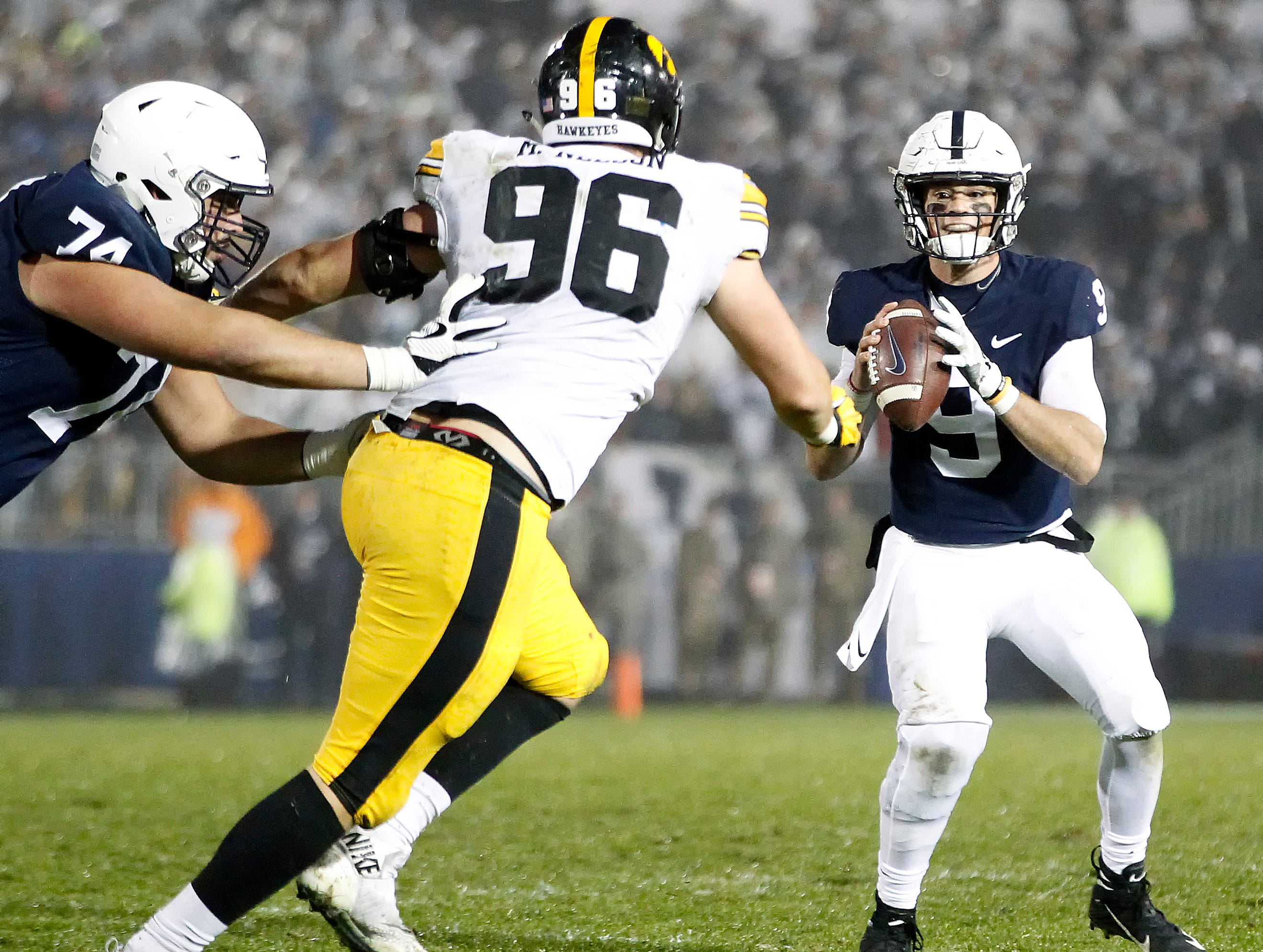 Penn State quarterback Trace McSorley (9) looks to pass as Iowa's Matt Nelson (96) applies pressure during the second half of an NCAA college football game in State College, Pa., Saturday, Oct. 27, 2018. (AP Photo/Chris Knight)