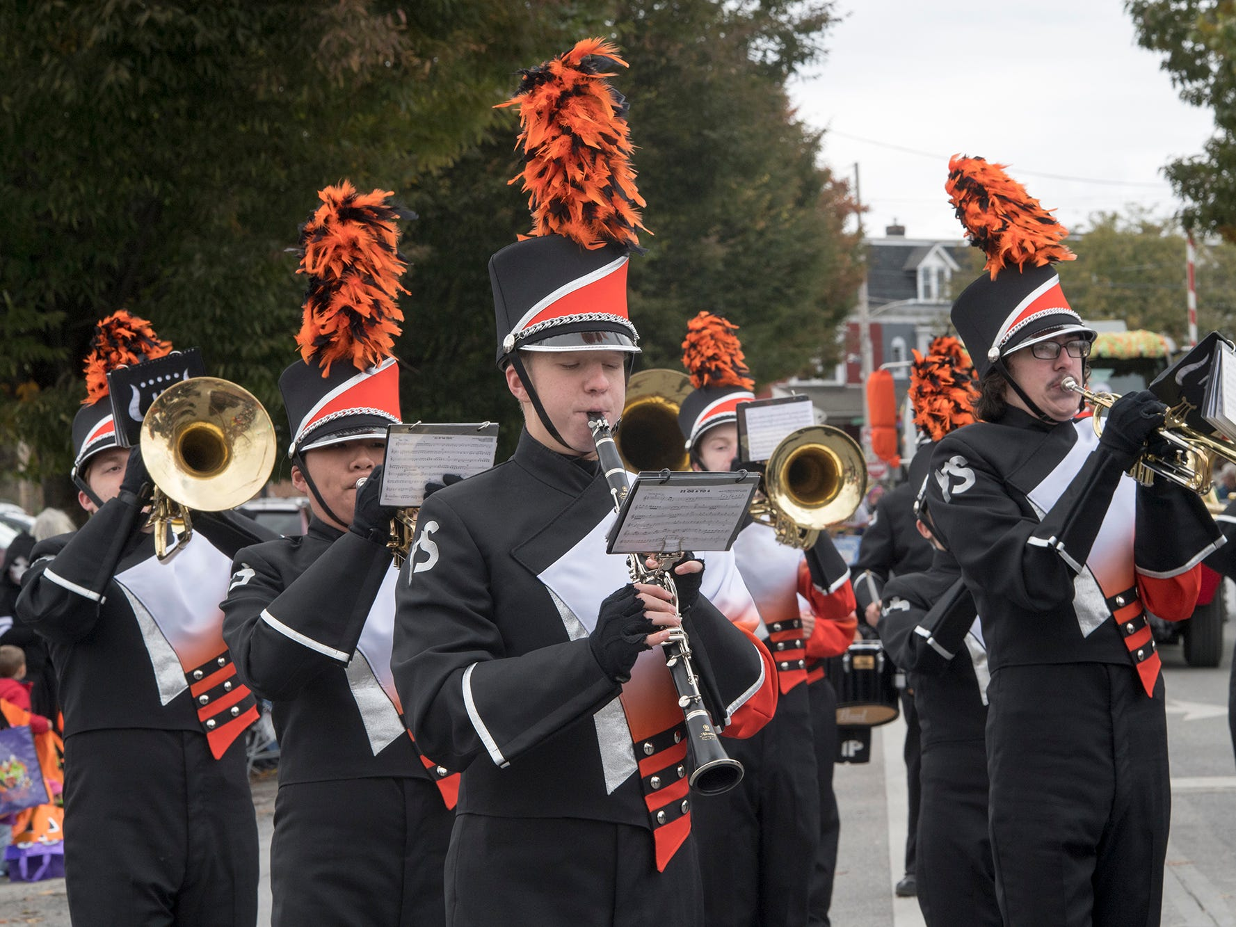 York Suburban High School marches during the 69th Annual York Halloween Parade presented by York Traditions Bank Sunday in York works its way east on Market Street.