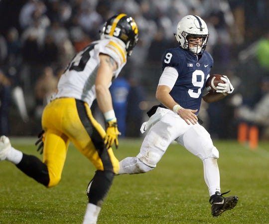 Penn State quarterback Trace McSorley (9) takes off running against Iowa during the second half of an NCAA college football game in State College, Pa., Saturday, Oct. 27, 2018. Penn State won 30-24. (AP Photo/Chris Knight)