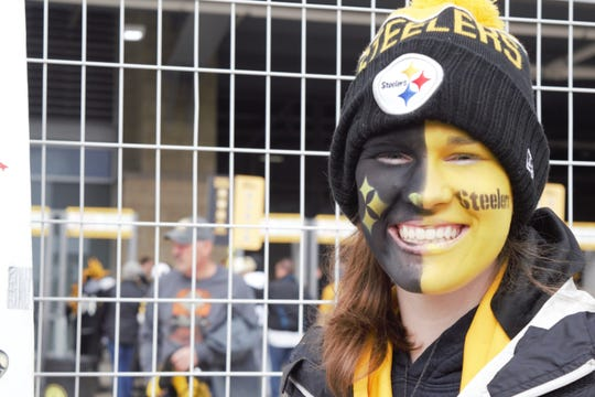 Aaleya Williams of Apollo, PA stands outside of Heinz Field. Williams has been helping paint the faces of Steelers Nation for over three years.