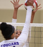 Bishop Manogue's Eleanor Salkoff goes up to block a shot by Spanish Springs' Kylie Hopkin at Manogue High School on Sept. 18. Manogue defeated Spanish Springs, 3-0.