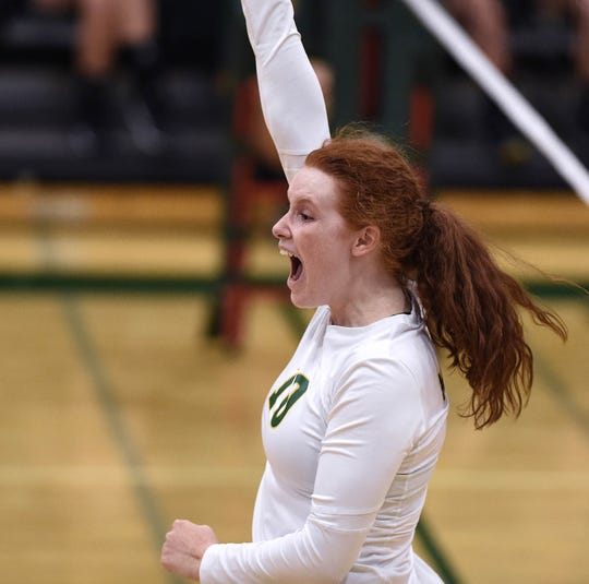 Bishop Manogue's Emma Pence celebrates a point aganist Spanish Springs at Manogue High School on Sept. 18, 2018. Manogue defeated  Spanish Springs, 3-0.