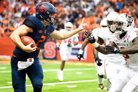 Syracuse quarterback Eric Dungey runs with the ball during the first quarter of Saturday night's 51-41 win over North Carolina State.