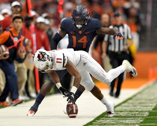 Syracuse defensive back Evan Foster, top, breaks up a pass intended for N.C. State wide receiver Jakobi Meyers during the first half on Saturday night.