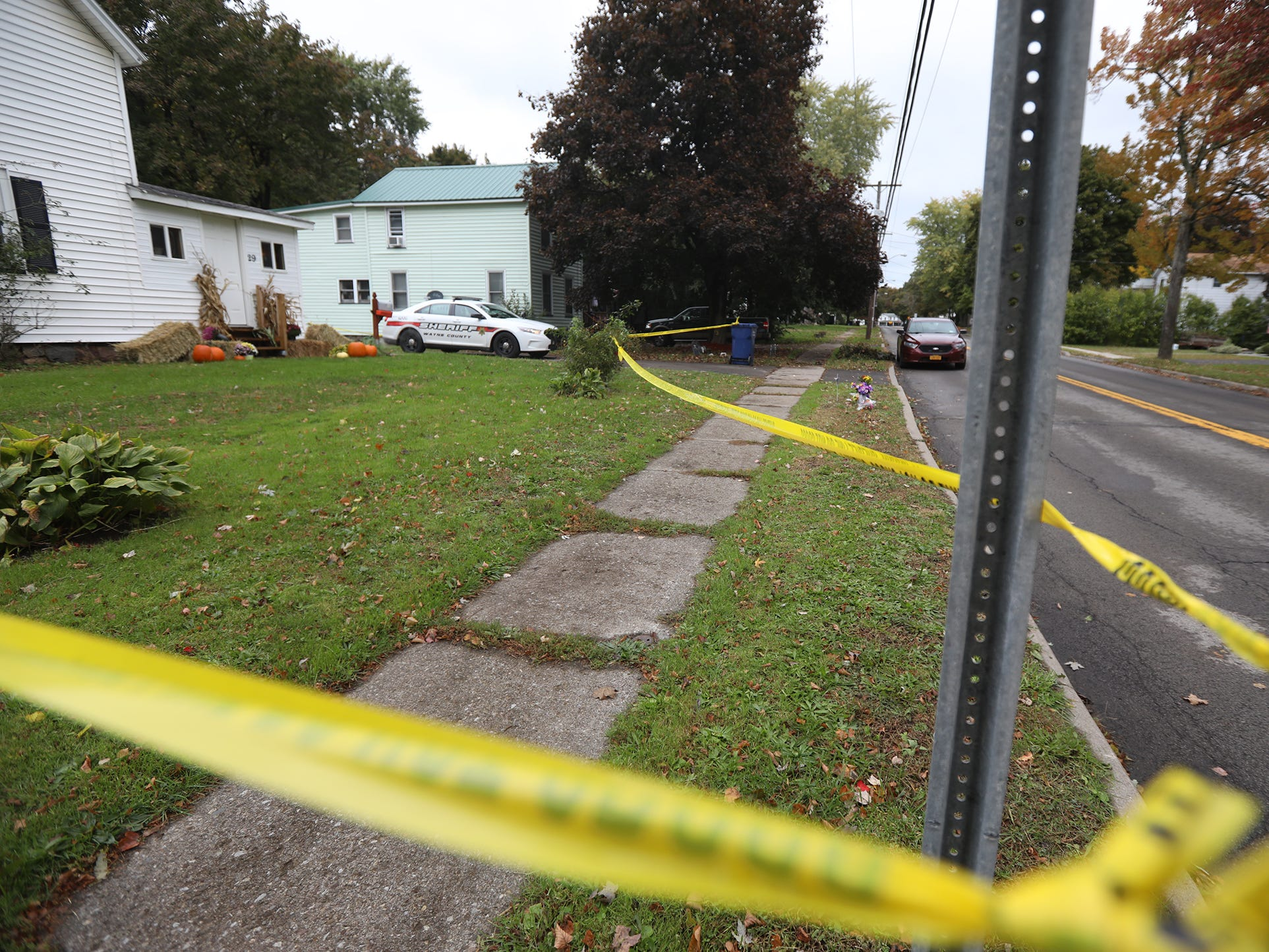 Yellow crime tape and a deputy's car remained at the residence of Joshua Niles and Amber Washburn days after they were fatally shot on Oct. 22, 2018.
