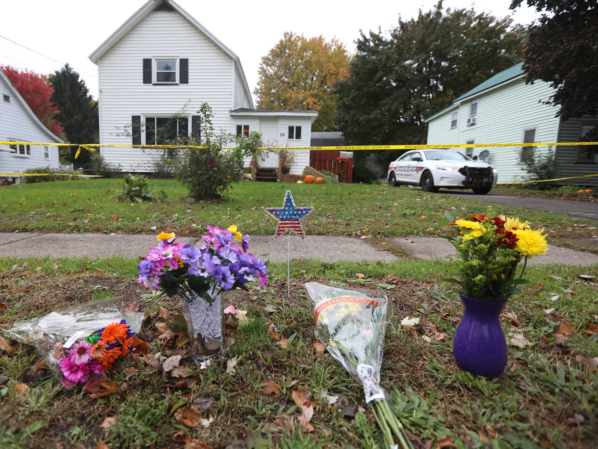 Joshua Niles and Amber Washburn were killed outside their home Oct. 22, 2018. Flowers were left outside their home several days later.