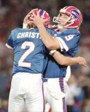 Chris Mohr, right, hugs Steve Christie after Christie kicked the winning field goal to beat the Cleveland Browns in the last seconds of the game.