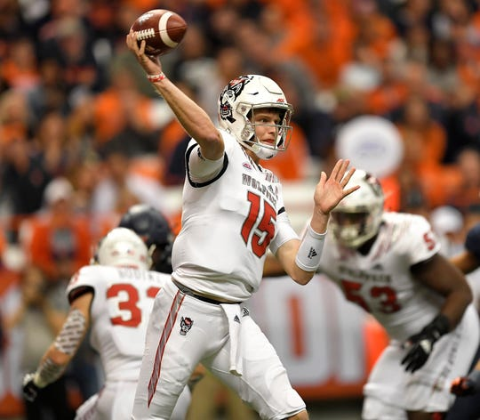 North Carolina State quarterback Ryan Finley throws a pass from the pocket during the second half of Saturday night's game at the Carrier Dome.
