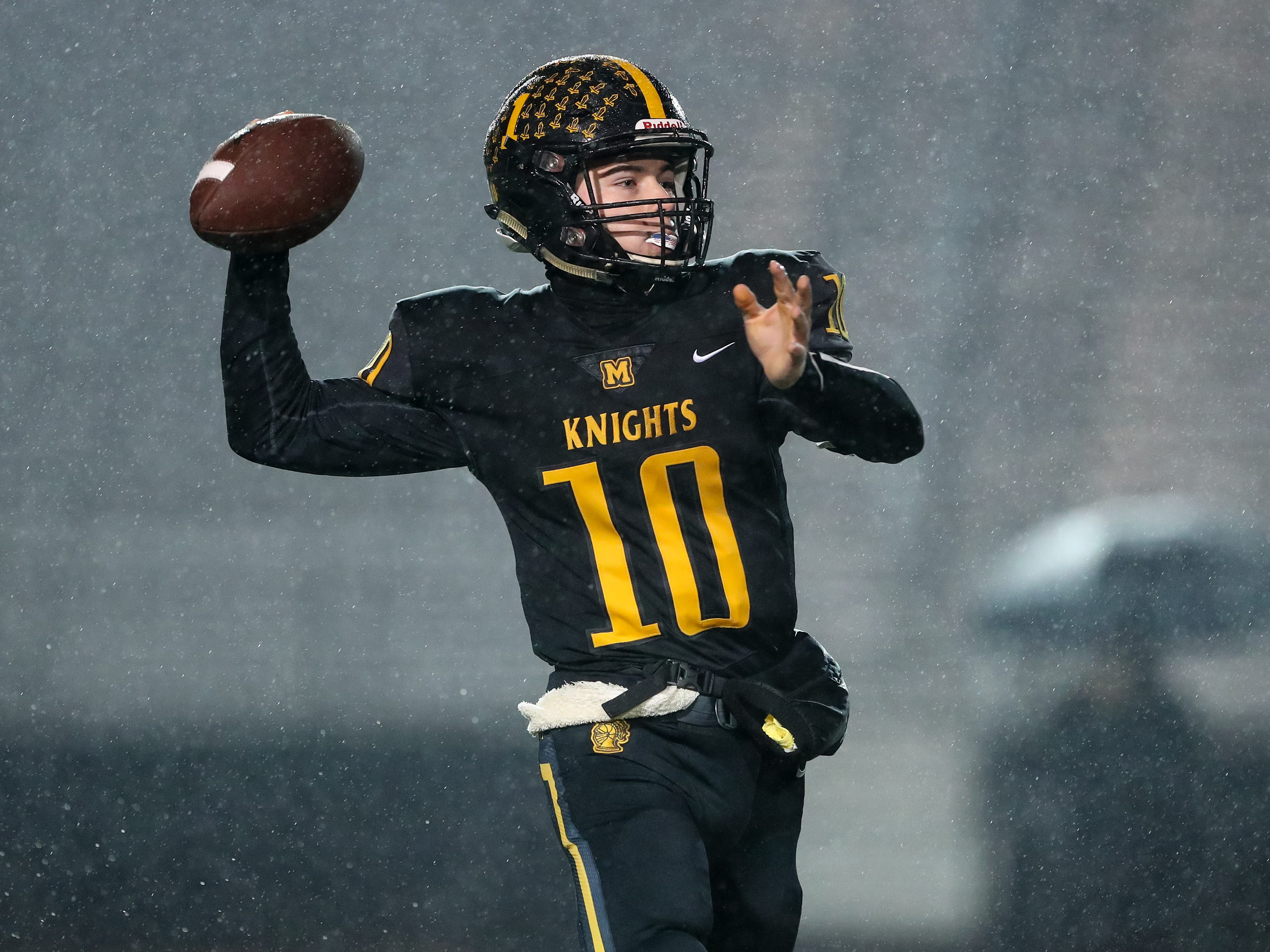 McQuaid quarterback Hunter Walsh (10) throws a pass against Hilton during McQuaid's 40-0 win over the Cadets in the Section V Class AA semifinals on Saturday night.