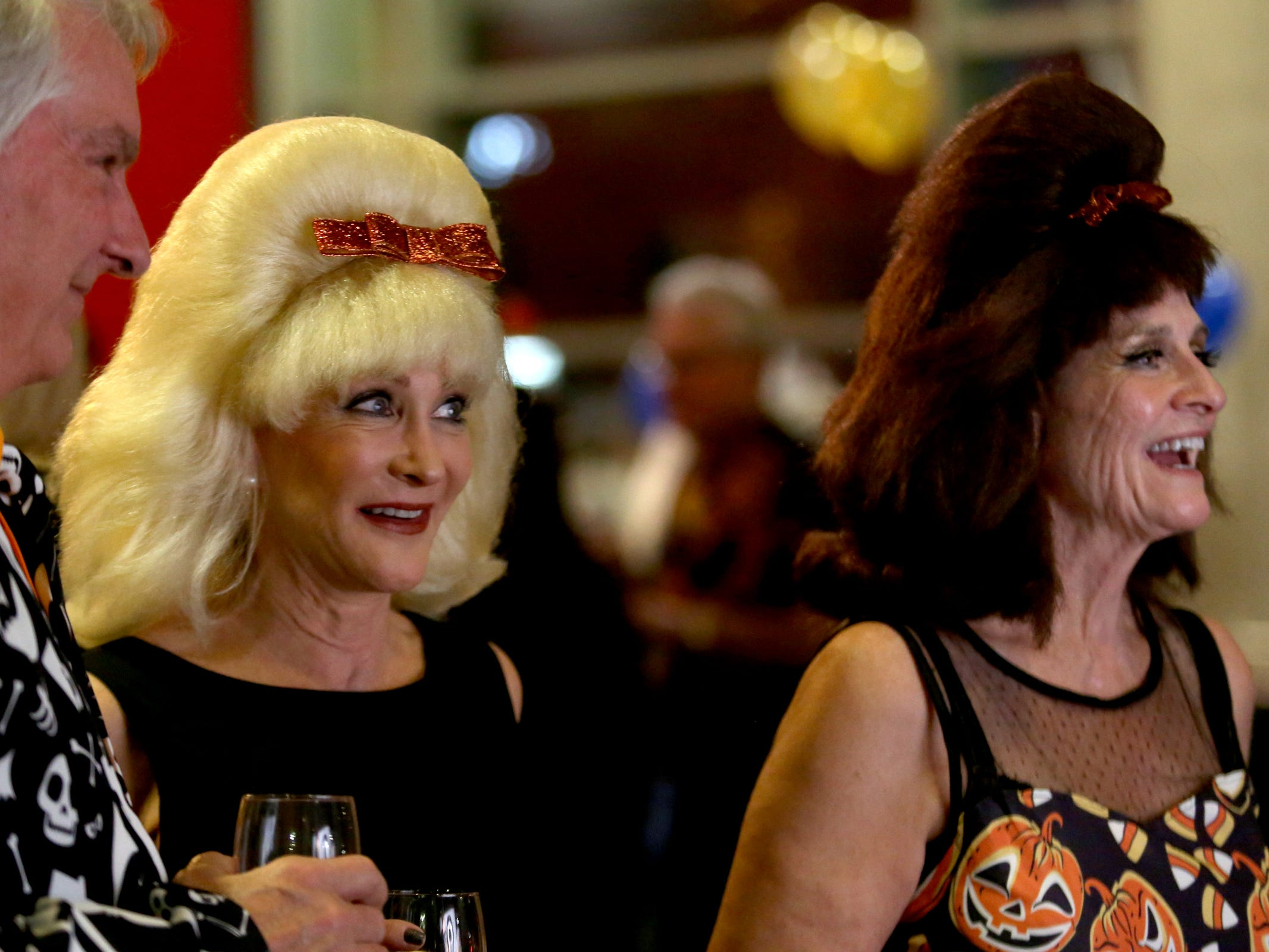 Merritt Mount, from left, of Olympia, Wash., Deb Fitz, of Seattle, Wash., and Fran Howe, of Gates, attend Bowser's Boo Bash, a fundraiser for the Willamette Humane Society, at the Salem Convention Center on Saturday, Oct. 27, 2018.