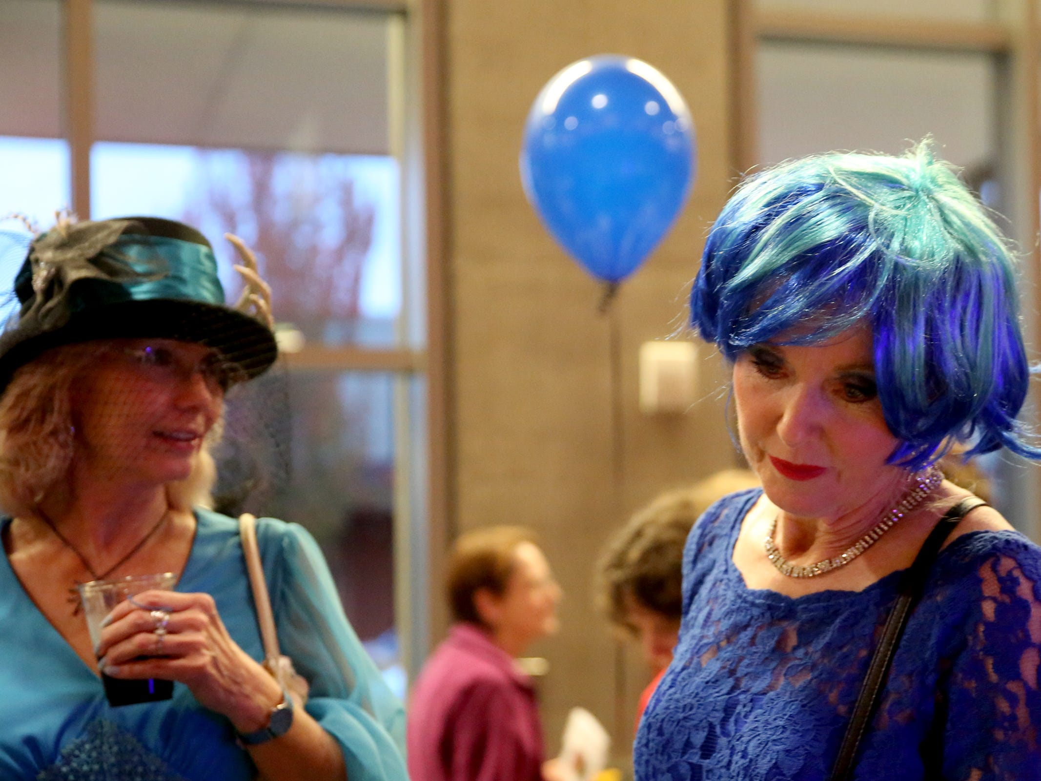 Kathy Bobbio, left, and Laurel Hines, both of Salem, look at items available for auction at Bowser's Boo Bash, a fundraiser for the Willamette Humane Society, at the Salem Convention Center on Saturday, Oct. 27, 2018.