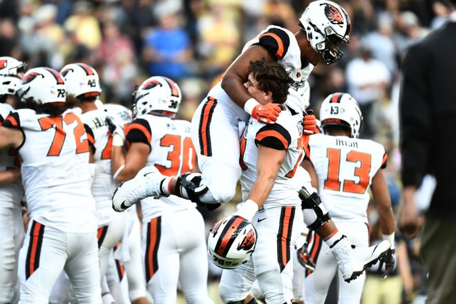 Oct 27, 2018; Boulder, CO, USA; Members of the Oregon State Beavers celebrate following an overtime win against the Colorado Buffaloes at Folsom Field. Mandatory Credit: Ron Chenoy-USA TODAY Sports