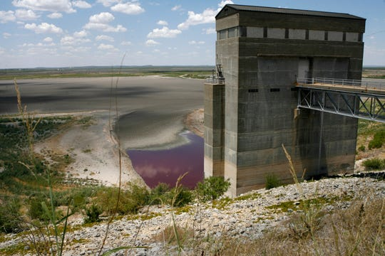 A view from the O.C. Fisher Dam reveals the devastation the lack of rainfall and 100-degree temperatures has had on the reservoir in the San Angelo State Park on Aug. 3, 2011.