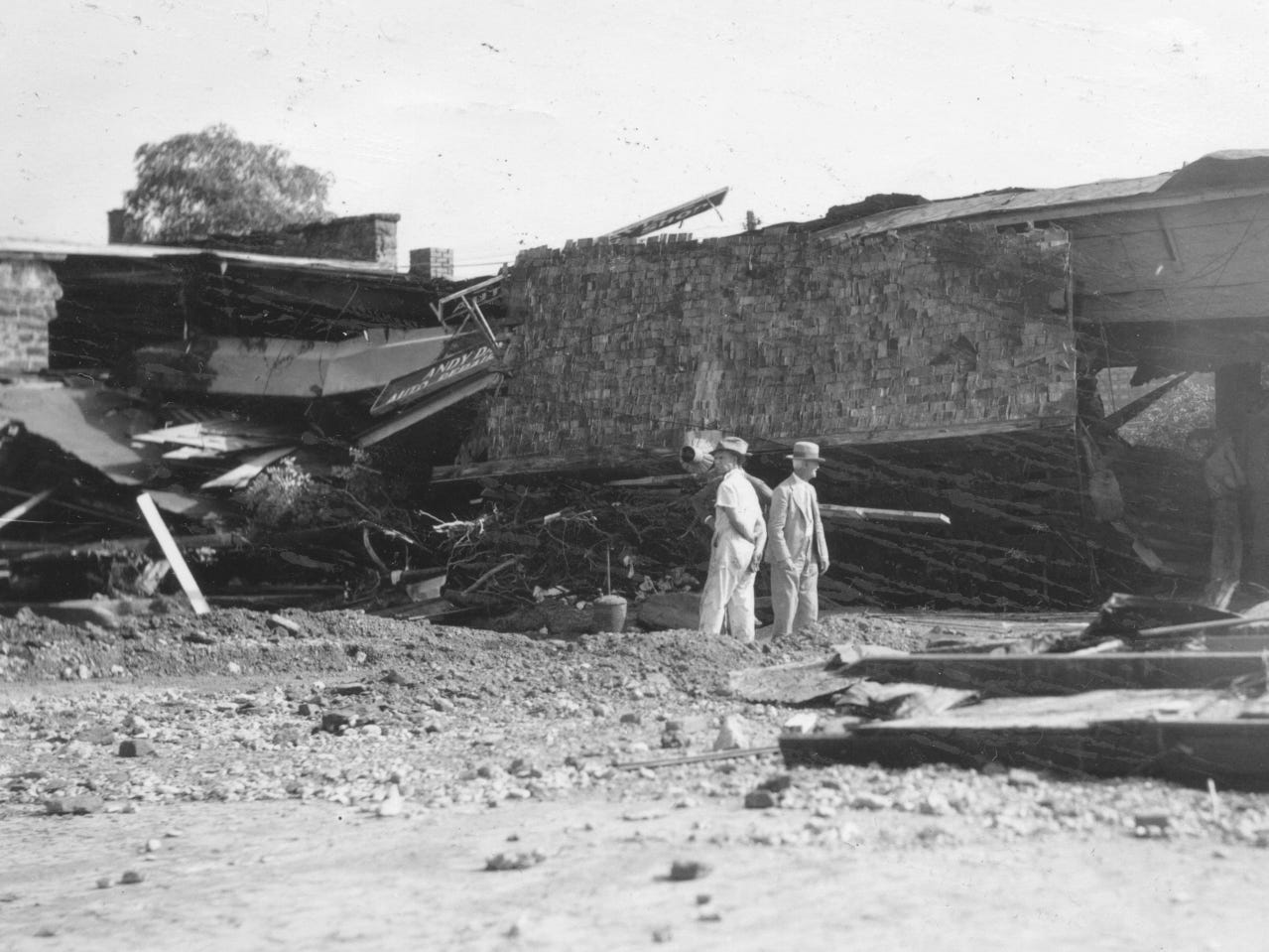 Damage from the San Angelo flood of 1936 is checked.