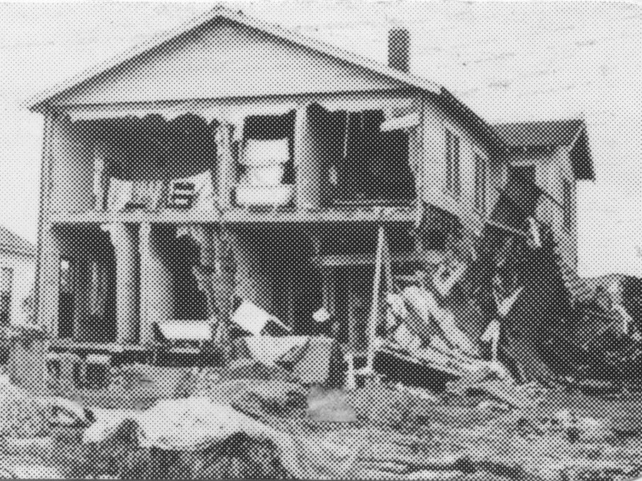 A house is damaged from the San Angelo flood of 1936.