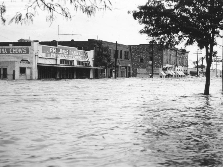 Flood waters fill the streets of San Angelo as seen on Oakes Street from post office during flood of 1936.