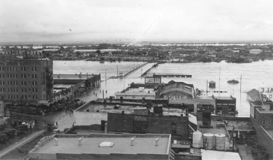 Disaster struck in 1936 when a flood carried a telephone pole through the Ritz Theater screen and the building.