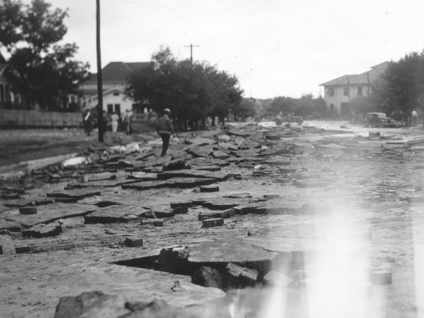 People walk around looking at the aftermath of the San Angelo flood of 1936.