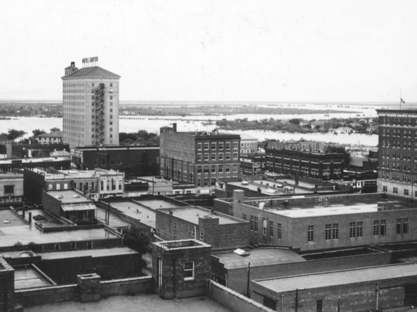 View from the McBurnett Building toward forks of rivers in 1936 flooding.