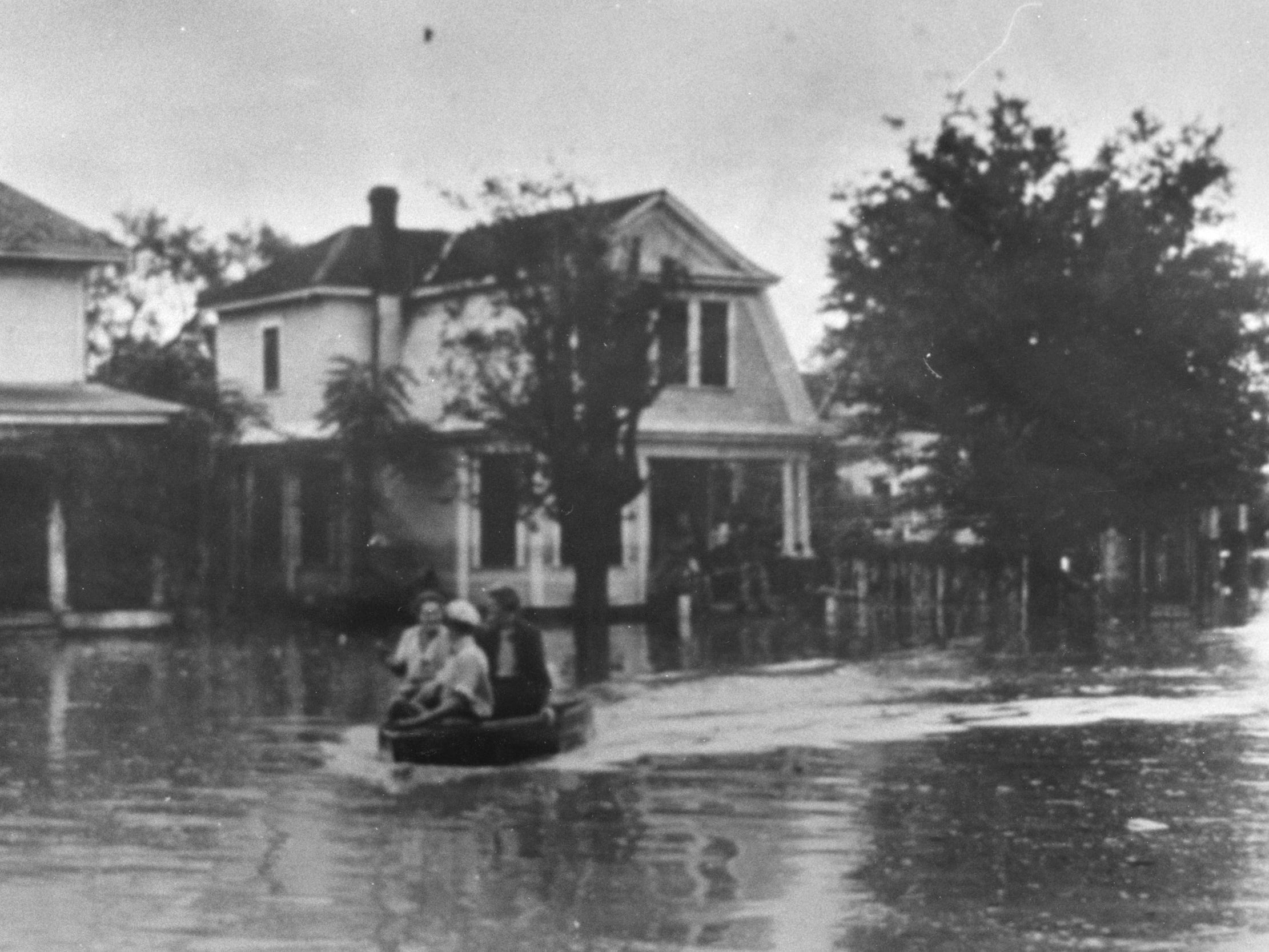 People boat on West Harris Avenue during the 1936 flood.