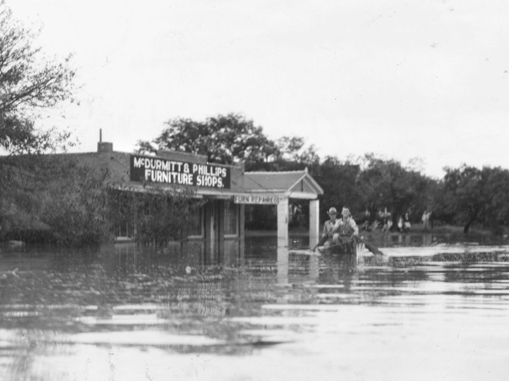 People boat in the streets of San Angelo during the flood of 1936.