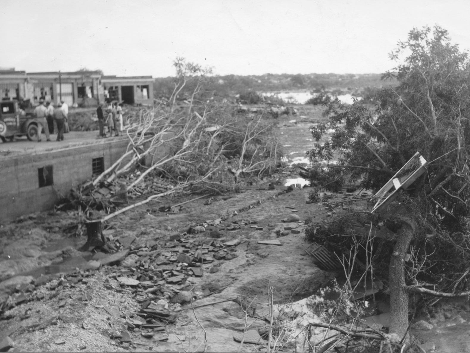 People survey damage from the San Angelo flood of 1936.