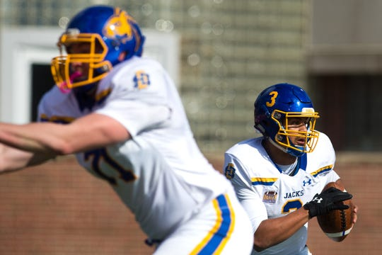 South Dakota State quarterback Taryn Christion drops back to pass during the Jackrabbits' 38-28 Missouri Valley Football Conference victory over Illinois State on Saturday, Oct. 27, 2018, at Hancock Stadium in Normal, Ill.