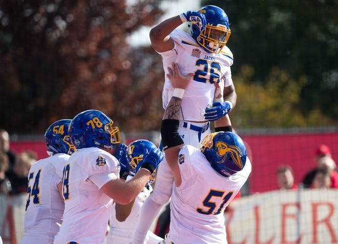 South Dakota State's Mikey Daniel (26) gets a lift from his teammates during their Missouri Valley Football Conference game against Illinois State on Saturday, Oct. 27, 2018, at Hancock Stadium in Normal, Ill. The Jackrabbits won, 38-28.