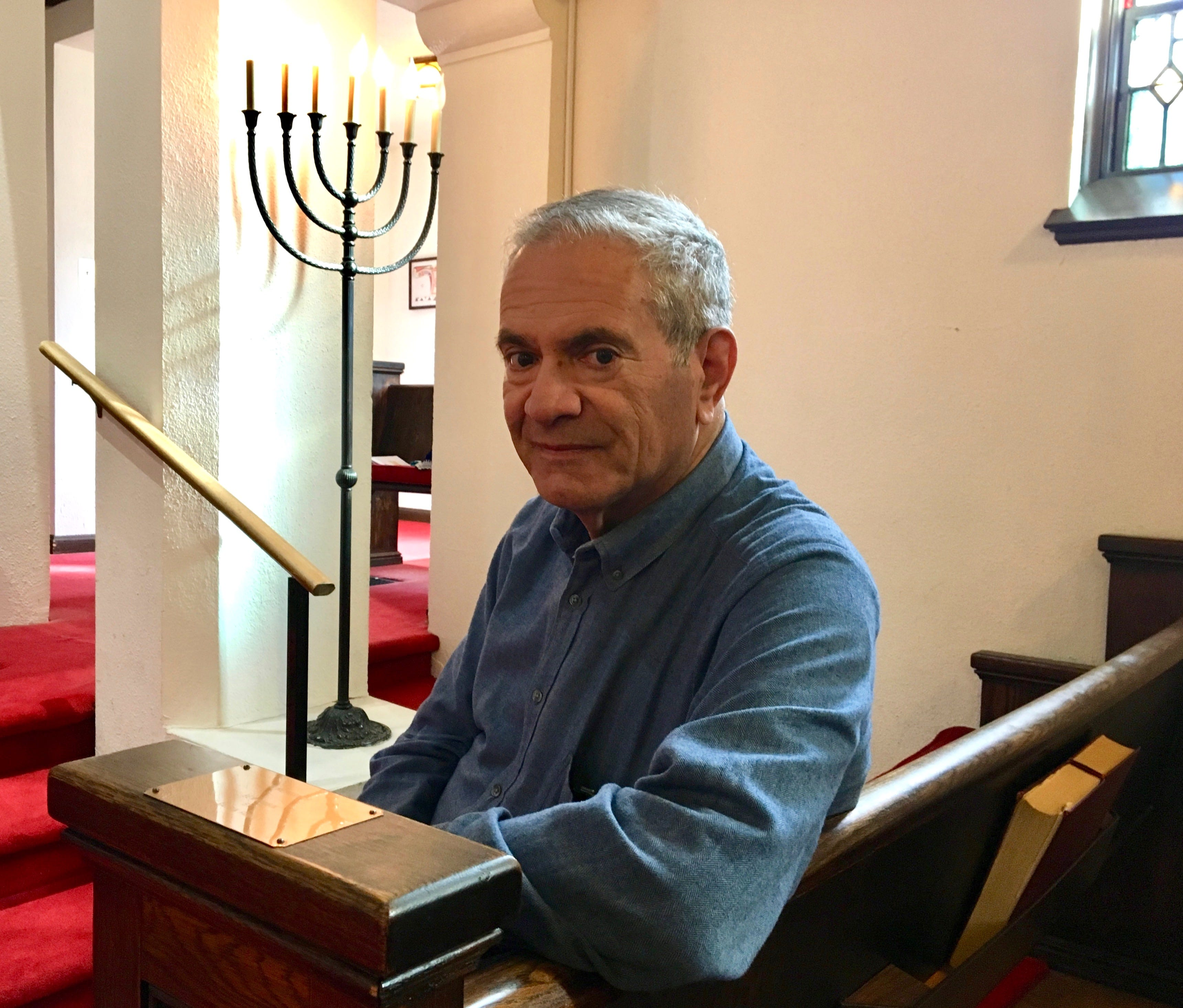 Rabbi Peter Grumbacher sits inside the sanctuary at Temple House of Israel in Staunton on Sunday, October 28, 2018, the day after the deadliest attack against the Jewish community in the history of the United States.