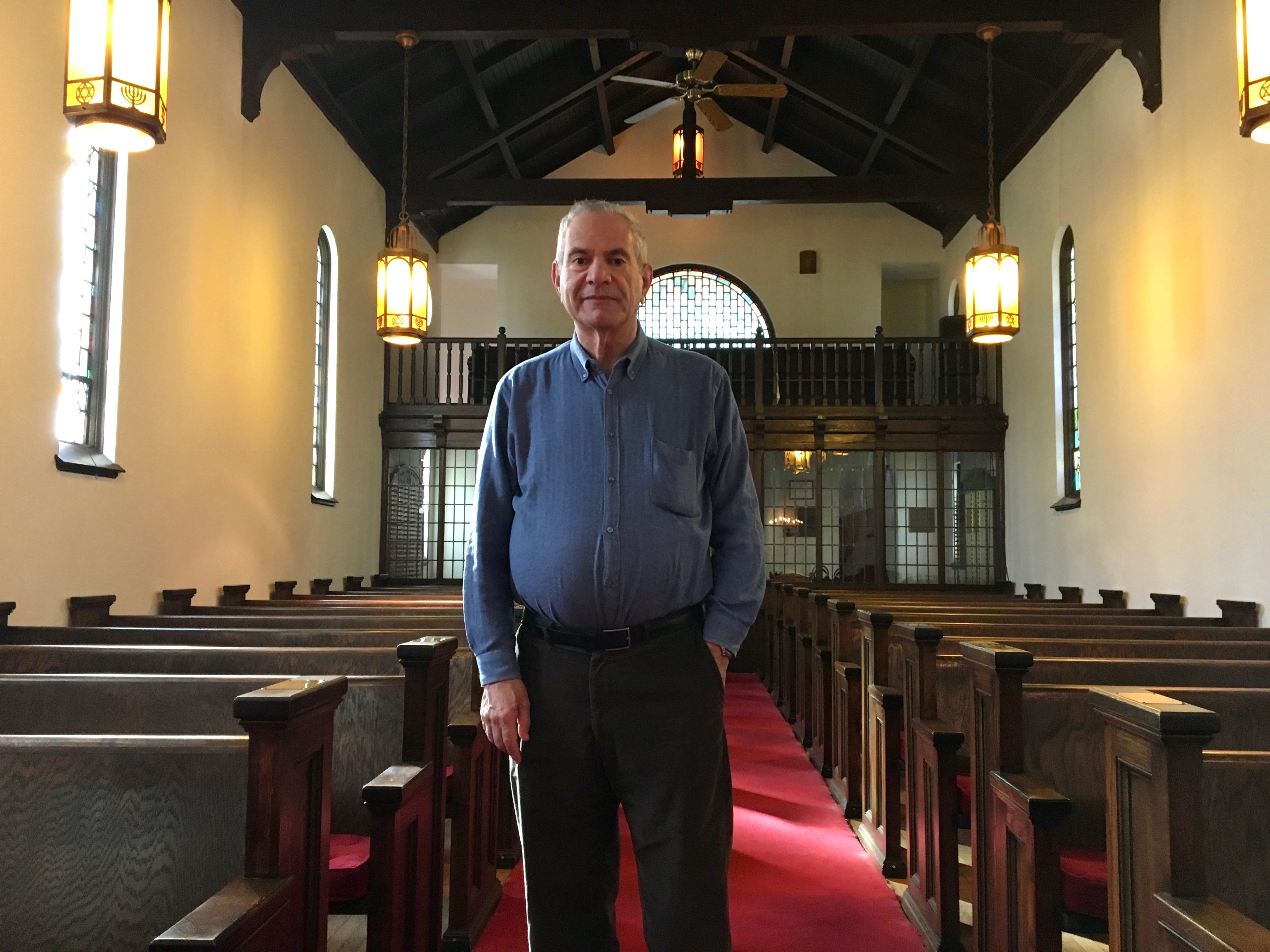 """Rabbi Peter Grumbacher sits inside the sanctuary at Temple House of Israel in Staunton on Sunday, October 28, 2018, the day after the deadliest attack against the Jewish community in the history of the United States. """"The time is now for the general community to take action to stop the hate."""""""