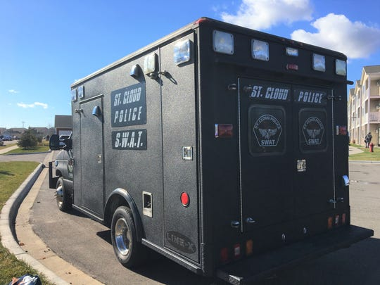 St. Cloud Police S.W.A.T. team responds to a wellness check on a man known to have guns Sunday in Sauk Rapids.