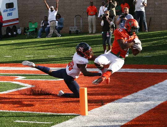 FAMU wide receiver Xavier Smith scores a touchdown over Morgan State's Marquise Thorns. The Rattlers crushed the Bears 38-3.