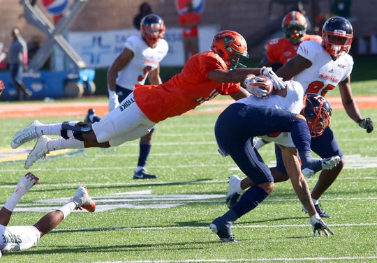 FAMU linebacker Elijah Richardson dives for a tackle on Morgan State wide receiver Manasseh Bailey.