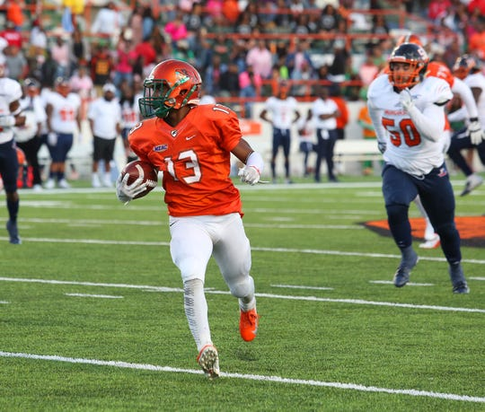 FAMU running back Bishop Bonnett breaks free on a long run.