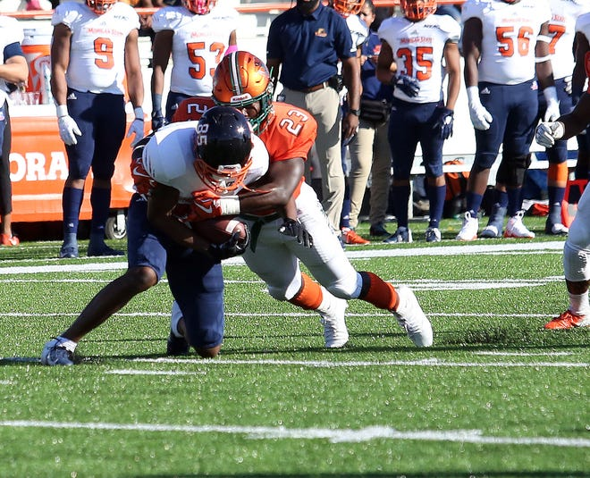 FAMU nickleback Terry Jefferson tackles Morgan State wide receiver Daylen Baldwin.