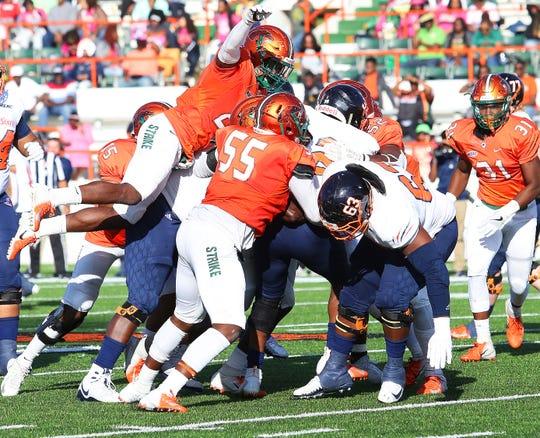 FAMU's defense gang tackles the Bears.