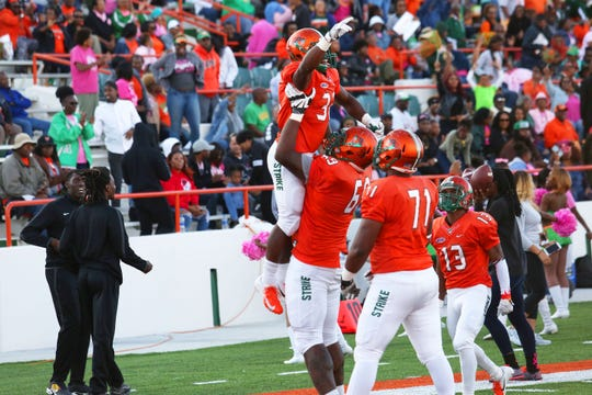 FAMU running back DeShawn Smith is hoisted in the air after scoring a touchdown versus Morgan State.