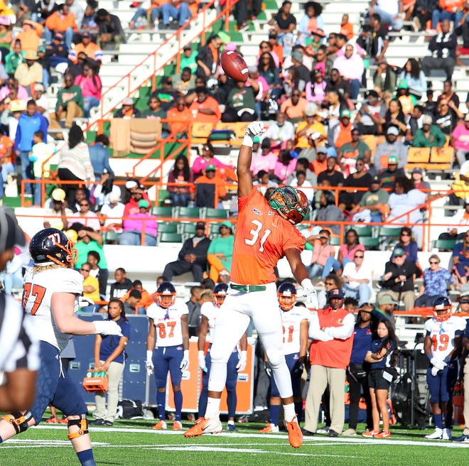 FAMU defensive end Antonio Miller shows off his athleticism by knocking down a pass against Morgan State.