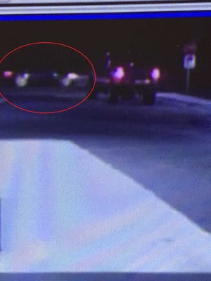 Police are searching for a newer, black sedan that was involved in a road rage shooting that left a young child in critical condition early Sunday.