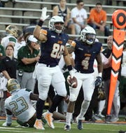UTEP wide receiver Josh Weeks, 86, points downfield after a run for a first down against UAB Saturday night in the Sun Bowl.