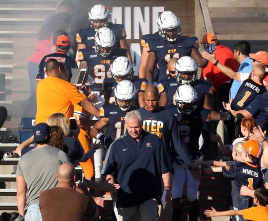 UTEP head coach Dana Dimel leads the Miners out of the mine shaft Saturday.