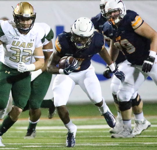 UTEP running back Terry Juniel, 2, finds a hole in the middle of the UAB line.