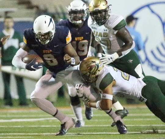 UTEP's Brandon Jones, 8, gets a few yards before UAB's Kris Moll, right gets a firm hold of him Saturday in the Sun Bowl Stadium.