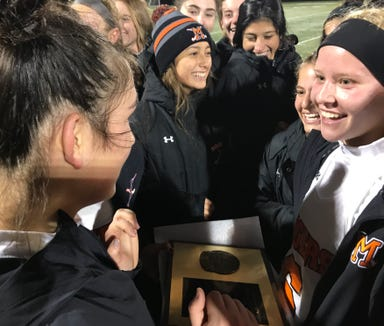 Mamaroneck field hockey players celebrate with the championship plaque after defeating Horace Greeley 2-0 in the Section 1 Class A title game at Brewster High School on Saturday, October 27th, 2018.