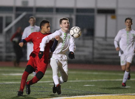 Solomon Schechter' s Ethan Mayblum (14) and Hamilton's Malin Barriga (17) battle for possession during the boys class C sectional soccer finals at Lakeland High School in Shrub Oak on Saturday, October 27, 2018.