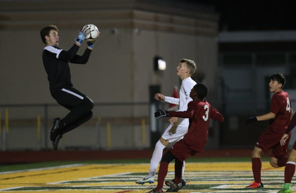 Ketcham goalie John Varasi (1) pulls in a save during their 2-1 win over Ossining in the boys class AA sectional soccer finals at Lakeland High School in Shrub Oak on Saturday, October 27, 2018.