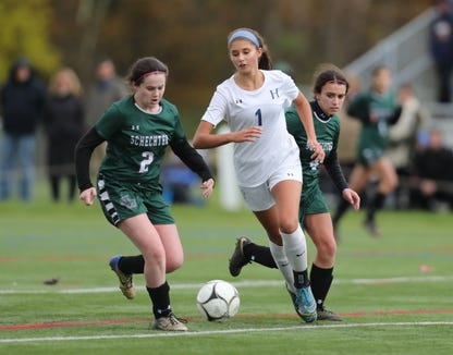 Haldane's Jade Villella (1) works the ball across mid-field durin g their 4-0 win over Solomon Schechter in the girls Class C soccer sectional finals at Arlington High School in Freedom Plains on Sunday, October 28, 2018.